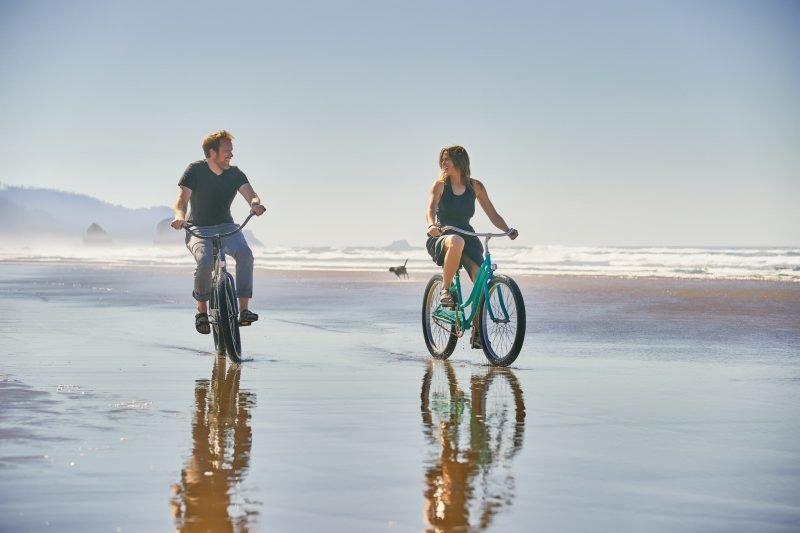 Riding bikes on the beach in Cannon Beach, Oregon